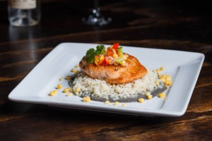 Salmon en Huitlacoche. Pan seared, then baked to tender, flaky perfection this fresh salmon is topped with huitlacoche sauce and mango-papaya salsa